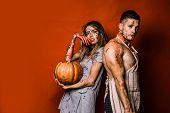 Creepy Scary Halloween Vampire Girl And Big Muscular Man Looking Camera And Holding Pumpkin. Terrify poster
