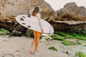 Surf Woman With Surfboard Going To Ocean For Surfing. Beautiful Surfer Girl. poster