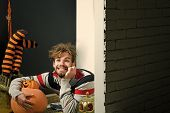 Halloween Holidays Celebration Concept. Man With Messy Hair Happy Smiling On Floor. Autumn And Harve poster