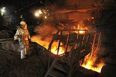 image of blast-furnace  - Molten hot steel pouring and worker - JPG
