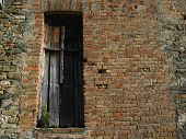 Old Brick Wall With Weathered Door poster