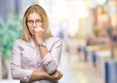 Young caucasian business woman wearing glasses over isolated background looking stressed and nervous poster
