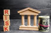 Dollars, Government Building And Inscription risk On Wooden Blocks.the Risk Of Investing In A Busi poster