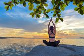 Healthy Yoga Woman Lifestyle Exercising Vital Meditate And Energy Yoga On The Rock Near The Seashore poster