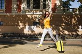 Young Laughing Traveler Tourist Woman In Yellow Summer Casual Clothes Hat With Suitcase City Map Jum poster
