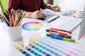 Image Of Female Creative Graphic Designer Working On Color Selection And Drawing On Graphics Tablet  poster