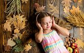 Child Listen Music Relaxing Top View. Fall Melody Concept. Fall Music Playlist. Best Songs About Fal poster