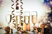 champagne glasses against holiday lights ready for New Years eve party poster