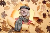 Fashion Portrait Of Beautiful Sensual Woman. Autumn Woman Holding Gold Leaf. Sensual Woman Wearing P poster