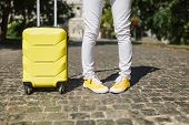Cropped Image Of Fun Traveler Tourist Woman Legs In Yellow Summer Casual Clothes With Suitcase On Ro poster