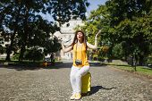 Young Dissatisfied Traveler Tourist Woman In Yellow Clothes Sitting On Suitcase Holding City Map Spr poster