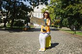Concerned Traveler Tourist Woman In Yellow Clothes Hat Sit On Suitcase Looking On City Map Search Ro poster