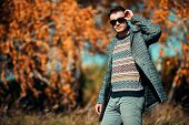 A handsome man in countryside. Autumn fashion for men. Freedom, lifestyle. poster