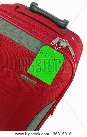 red travel bag and green tag