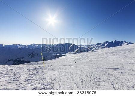 Ski Slope And Blue Sky With Sun