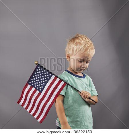 Young Boy Holds Flag On Shoulder