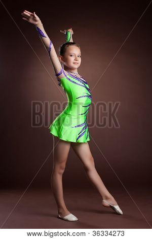 Beauty child gymnast training in studio