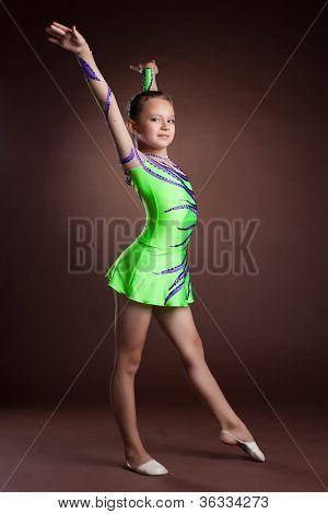 Beauty child gymnast training in studio