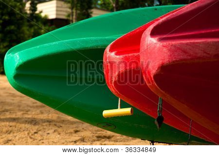 Three Canoes In A Row On The Beach