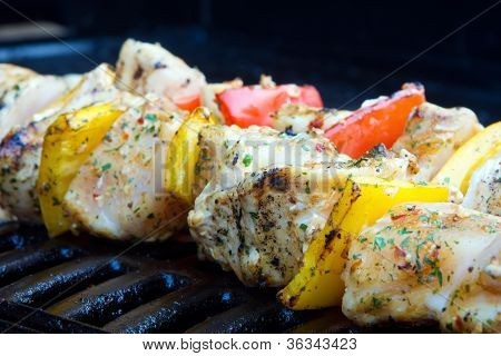 Chicken And Pepper Kebabs Slowly Cooking On The Barbecue