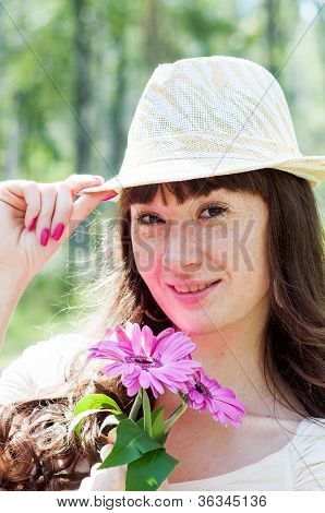 Beautiful girl with colorful flowers