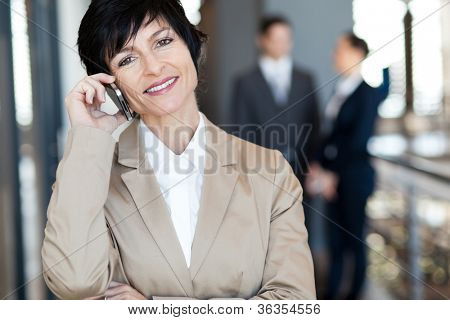 middle aged businesswoman talking on cell phone