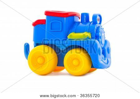 Juguete que un infantiles de plástico, una locomotora de brillantes tonos de vapor.