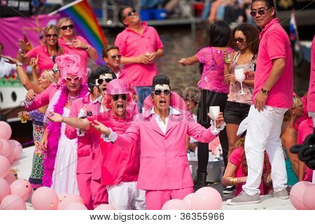 AMSTERDAM, THE NETHERLANDS - AUGUST 4: Participants dance in front of spectators at the famous Canal Parade of the Amsterdam Gay Pride 2012 on August 4, 2012 in Amsterdam