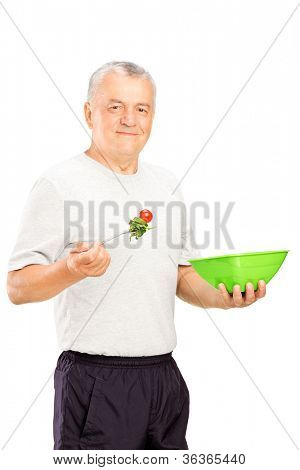 A mature sports man eating a healthy food isolated on white background