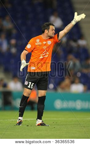 BARCELONA - AUG, 3: Geoffrey Jourdren of Montpellier HSC in action during a friendly match against RCD Espanyol at the Estadi Cornella on August 3, 2012 in Barcelona, Spain