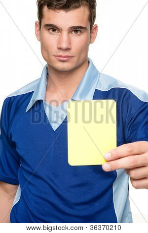 Young  referee with yellow card in front of white background