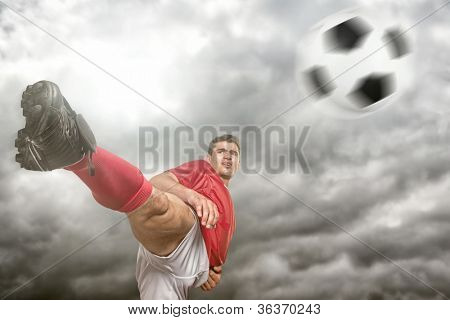 Soccer player in front of dramatic sky