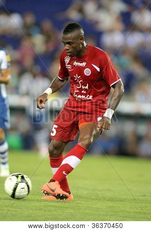 BARCELONA - AUG, 3: Henri Bedimo of Montpellier HSC in action during a friendly match against RCD Espanyol at the Estadi Cornella on August 3, 2012 in Barcelona, Spain