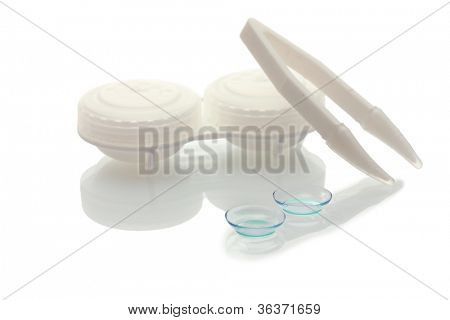 contact lenses, containers and tweezers isolated on white