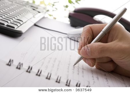 Businessman Brainstorming And Writing Notes