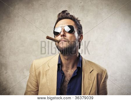 Elegant young man smoking a cigar