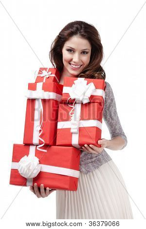 Pretty woman hands many presents wrapped in red paper, isolated on white