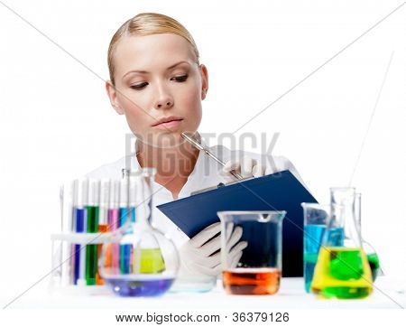 Doctor notes something after the experiment, isolated on white