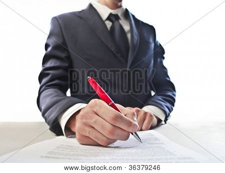 Closeup of a businessman's had signing a document