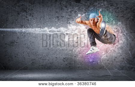 young man in a blue cap dancing hip hop - collage