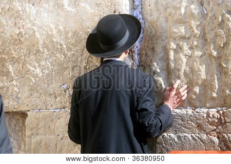 JERUSALEM - JANUARY 02: Jewish men pray at the western wall January 02, 2008 in Jerusalem, IL. The wall is one of the holiest sites in Judaism attracting thousands of worshipers daily.