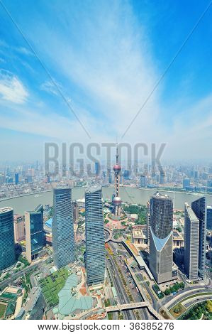 Shanghai city aerial view in the day with blue sky and cloud with Oriental Pearl Tower