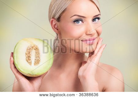 beautiful woman with perfect skin,  melons for perfect complexion,
