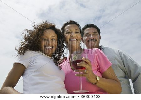 Low angle view of an African American couple with a female friend