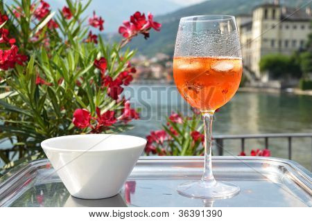Traditional Italian Spritz cocktail against lake Como, Italy