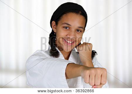 Teen girl doing karate at a studio