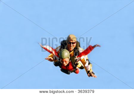Portrait Of Two Skydivers In Action