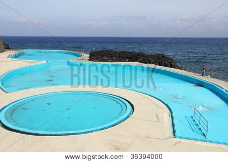 Picturesque, the freakish form swimming pool at coast of Atlantic ocean on island Madiera