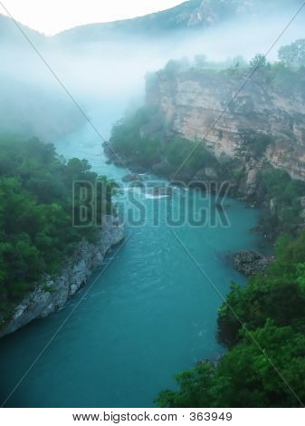 River Canyon In Fog