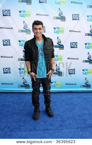 Los Angeles - AUG 19:  Adam Irigoyen arrives at the 2012 Do Something Awards at Barker Hanger on August 19, 2012 in Santa Monica, CA